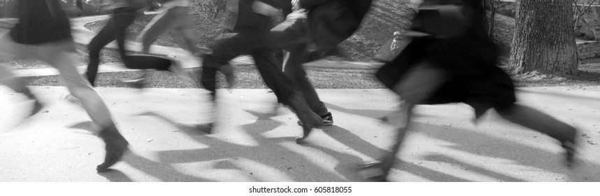Motion concept: A group of people running -  - black and white web banner, cinematic motion blur