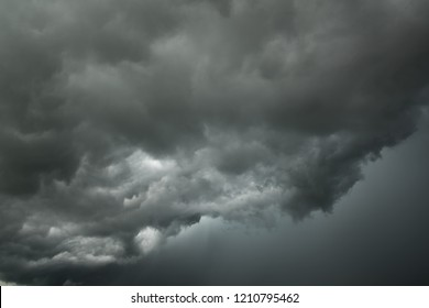 Motion of dark sky and black clouds, Dramatic cumulonimbus cloud with rainy