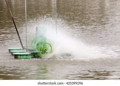 The motion image of aerator turbine wheel fill oxygen into water in park lake