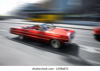 motion image. red retro car in the city