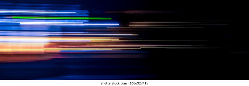 motion light trails on the dark background