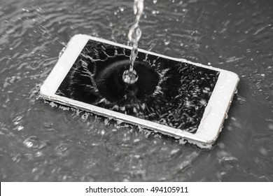 Motion movement of water poured over a smartphone / a wet smartphone concept