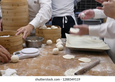 Motion of people are kneading the dough before it to be made dumplings inside restaurant kitchen