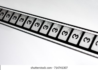 Motion picture film strip. Film countdown leader with the number three on it.
