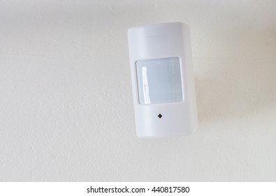 Motion sensor or detector for security system mounted on wall.