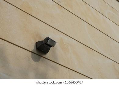 Motion sensor on outdoor wall