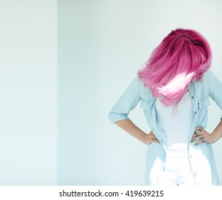 Motion shot of woman's hair. Dyed hair in daylight concept.