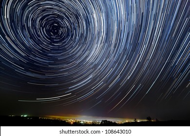 The motion of stars around Pole Star in the night city