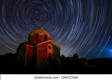 The motion of the stars are shown in the sky above the austere chapel of Agios Ioannis Prodromos close to cape Sounio, in Attica, Athens, Greece., on the night of the 15th of July 2017