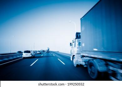 motion trucks on the freeway.