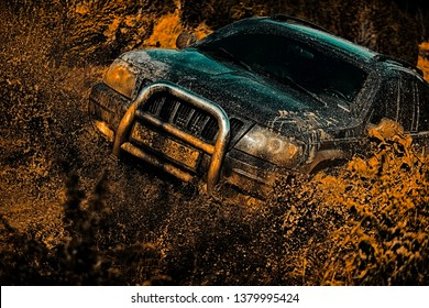 Motion the wheels tires and off-road that goes in the dust. Off road sport truck between mountains landscape. Rally racing. Tracks on a muddy field