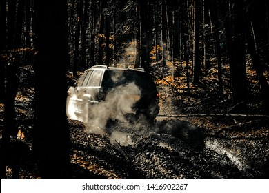 Motion the wheels tires and off-road that goes in the dust. Jeep crashed into a puddle and picked up a spray of dirt. Off road sport truck between mountains landscape