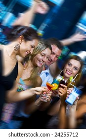 Motioned portrait of young attractive people having fun in night club
