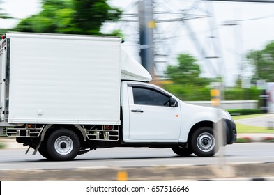 Motion,small white truck for logistics on the road.