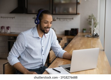 Motivated black man in headphones spend time for distant learning talk to teacher group mates on web conference. Confident biracial guy student get personal video consultation from tutor by video call
