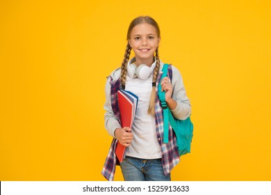 Motivated and diligent. Stylish schoolgirl. Girl little fashionable schoolgirl carry backpack. Schoolgirl daily life. School club. Modern education. Private schooling. Teen with backpack and books.