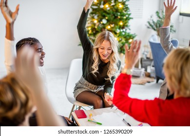Motivated excited multiracial female team giving high five celebrating corporate growth and financial success, happy group of MLM women partners join hands together showing unity in teamwork