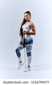 motivated well-built girl going to train with skipping rope, full length photo. wellness, wellbeing, leisure, free time, spare time, isolated white background