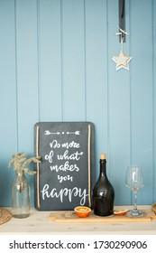"""Motivation interior sign """"Do more of what makes you happy"""". Ispiration to work."""