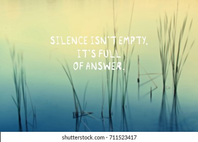 Motivation quotes - Silence isn't empty, it's full of answer. Blurred background.