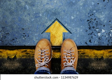 Motivation and Success Concept. Top View of Male with Leather Shoes standing on the Crossroad and Making Decision to Steps or Stop. Forward Arrow on the Floor as background