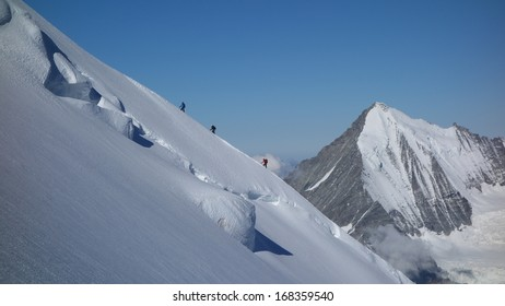 Motivation, Teamwork, Leadership - Climbing Dom with Weisshorn in Background
