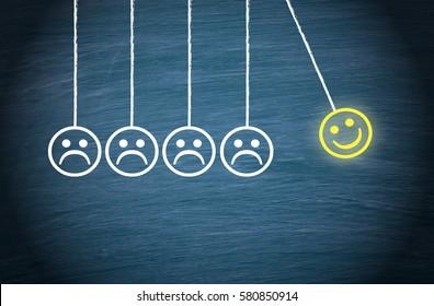 Motivation, Teamwork, Leadership and Coaching Concept - Smiley pendulum on blue background