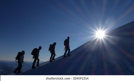 Motivation, Teamwork and Leadership - Mountaineering Rope Team at Sunrise