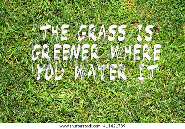 Motivation words the Grass is greener where you water it. Inspirational quotation. Perception, Care, Self development, ,Change, Life, Happiness concept.