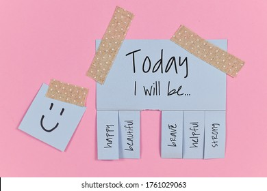Motivational concept with blue tear-off stub note with text 'Today I will be...' and words 'happy, beautiful, brave, helpful' and 'strong' on pink background