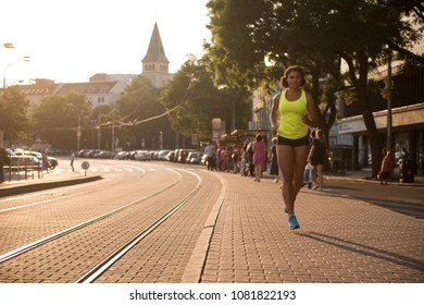 Motivational fitness woman running with determination