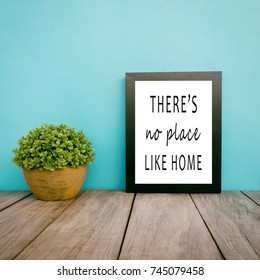 Motivational and inspirational life quotes - There's no place like home. Frame and plant with teal blue background, retro style.