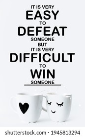 motivational inspirational positive life quote about that it is very easy to defeat someone but it is very difficult to win someone with the cups and white background