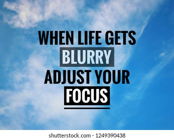 Motivational and inspirational quote - 'When life gets blurry, adjust your focus'. On blurred blue sky background.