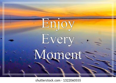 Motivational & inspirational quote with phrase Enjoy Every Moment with beautiful sunrise sky.