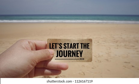 Motivational and inspirational quote - Let's start the journey on a piece of paper. With blurred vintage styled background.
