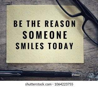 Motivational and inspirational quotes - Be the reason someone smiles today. With vintage styled background.