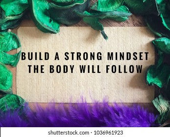Motivational and inspirational quotes - Build a strong mindset, the body will follow. With vintage styled background.