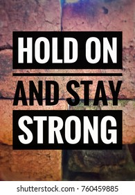 Motivational and inspirational quotes - Hold on and strong words with blurred and vintage background of stacked old bricks.