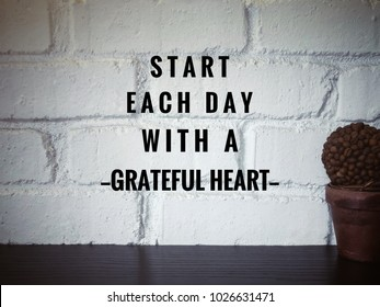 Motivational and inspirational quotes - Start each day with a grateful heart. With vintage styled background.