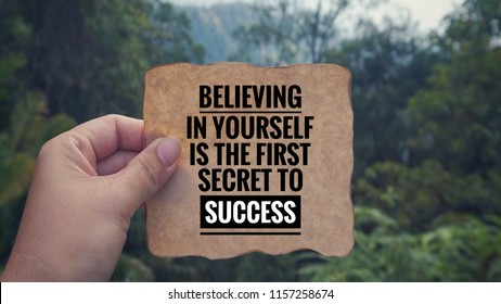 Motivational and inspirational quotes quotes - 'Believing in yourself is the first secret to success' written on a white paper. With vintage styled background.