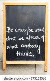 A motivational message on a chalk board