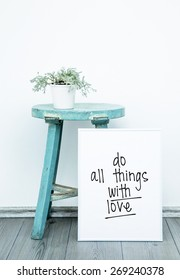 Motivational Poster quote DO THINGS WITH LOVE. Hipster scandinavian style room interior. White pot with flower on a blue coffee table