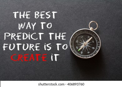 Motivational quote to create future ,on black background with compass