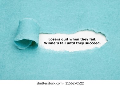 Motivational quote Losers Quit When They Fail Winners Fail Until They Succeed appearing behind ripped blue paper.