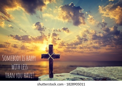 Motivational quote on sunrise background with sea and Christian cross