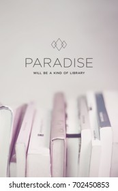 Motivational quote poster Paradise will be a kind of library, sans serif typography on low contrast and blurred photography of a library. Relaxing and modern design for positive thinking.