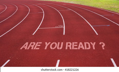 Motivational quote written on running track: Are You Ready?
