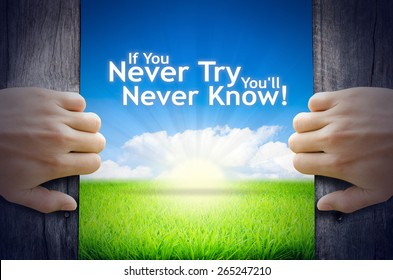 """Motivational quotes """"If you never try you will never know"""" . Hands opening a wooden door then found a texts floating among new world as green grass field, Blue sky and the Sunrise."""