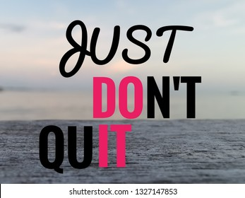 Motivational quotes Just Don't Quit (Do It) on nature background
